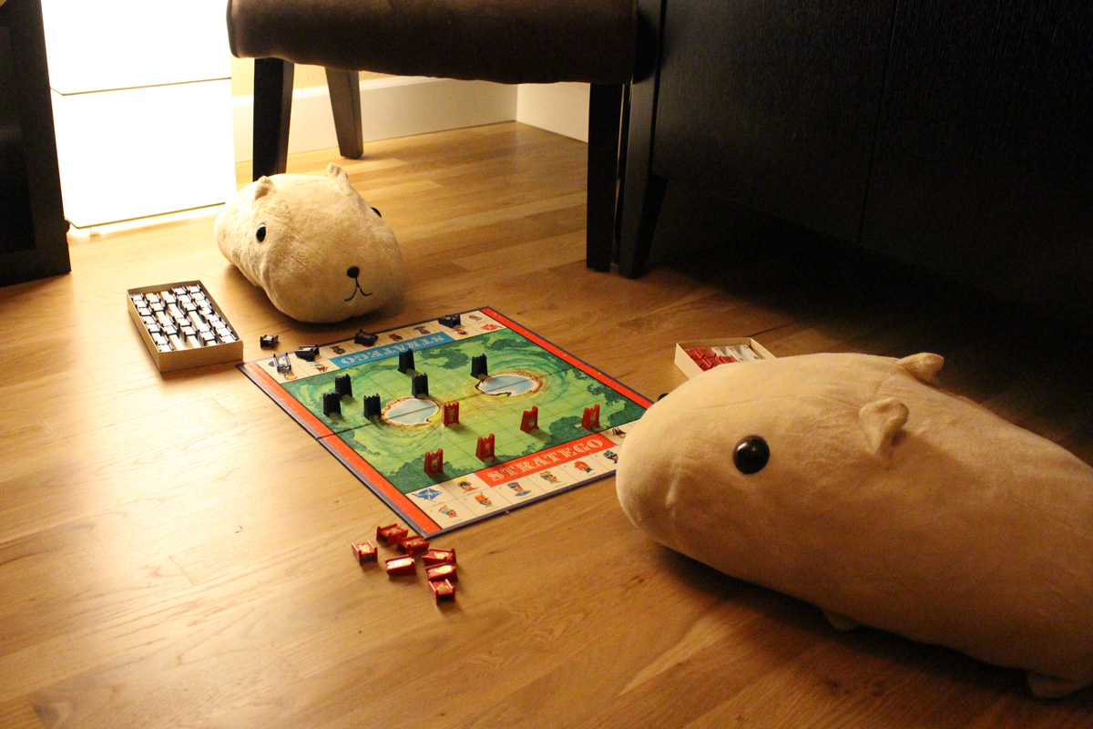 Capybaras playing Stratego